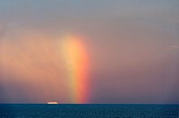 Rainbow over Baltic Sea and cruise ship, Europe.