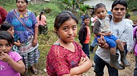 Chahal, Guatemala, a maya tribe in the jngle of Guatemala. A curious father is watching his daughter and carrying his son. The tribe is located 20 kil...