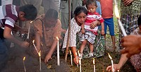 Chahal, Alta Verapaz, Guatemala, Maya tribe, burning candles are put into the ground for a good harvest and gratitude.