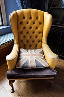 Chair with UK flag cushion.
