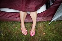 Feet outside a tent.