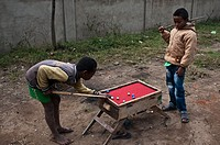 Two boys are playing billiards at Fianarantsoa ( Madagascar).