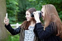 Gemert, Netherlands, two teenage girls are taking pictures in a photo class