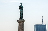 Victor Statue (Pobednik Monument) designed by Ivan Mestrovic, Upper City of Belgrade Fortress, Serbia. Usce Tower on background.