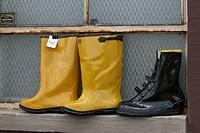 Rain boots for sale at a flea market in Chicago, Illinois USA.