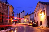Mayor street at nightfall of Bustarviejo, Madrid, Spain.