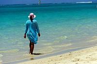 mature woman walking at the seaside, Pointe d'Esny beach, Grand Port District, Southeastern coast of Mauritius, Mascarene, Mascarene Islands, Mascaren...