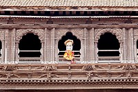 Newari architecture of the Pujari Math woodcarving museum building with a representation of the deity Betal staring out of the window, Tachupal Tole, ...