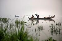Fishermen at work in the Taungthaman Lake , Amarapura, Myanmar.
