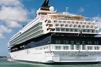 """The Cruise Liner """"""""Celebrity Century"""""""" anchored off Guernsey (St. Peter's port). allowing passengers to go ashore via launches."""