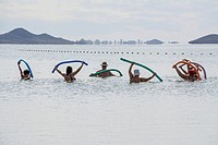 Excercising in the Mar Menor at Los Alcazares Beach in the region of Murcia, Costa Calida, Spain.