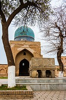 Bibi Khanum Mosque with huge marble Koran stand on foreground, Samarkand, Uzbekistan.
