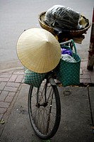 Traditional conical hat resting on a bicycle, Haiphong, North Vietnam, Asia.