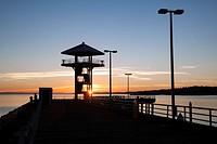 Sunrise at Port Angeles City Pier Observation Tower - Port Angeles, Washington, USA.