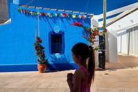 A girl in the centre of Sant Francesc village. Formentera (Balearic Islands).