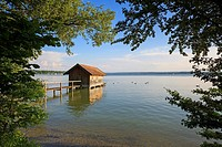 Wooden boathouse in Ammer lake. Upper Bavaria. Germany.