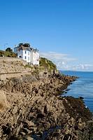 Houses built on rocks at Portmellon, Cornwall, England, United Kingdom.
