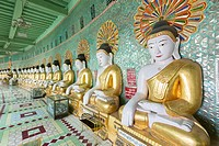 Buddha statues lining the crescent shaped colonnade of Umin Thounzeh pagoda, Sagaing, near Mandalay, Myanmar.
