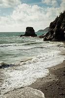 Rocky headland on the South West Coast Path near St Austell, Cornwall, England UK.