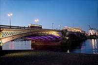 Bus crossing Blackfriars Bridge by night. London, England