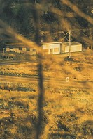 Hidden from plain sight a outback country cottage taken from bush vegitation.