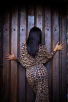 Woman rear-view long leopard dress