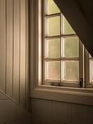 A loft window, frosted glass kjeeps out the glare.