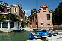 Boat loaded with drinks for local store moored in Venice, Italy