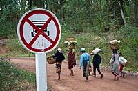 No vehicle road sign + local people walking on the road. Near Fianarantsoa ( Madagascar).