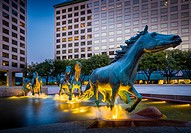 Mustangs at Las Colinas is a bronze sculpture by Robert Glen, that decorates Williams Square in Las Colinas in Irving, Texas. It is said to be the lar...