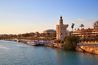 Seville sunset skyline torre del Oro in Sevilla Andalusia Spain.