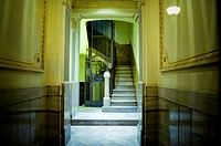 Entrance of a building apartment, corridor, elevator and stairs. Barcelona, Catalonia, Spain.
