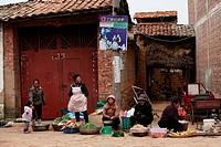 Street vendors in a small village, puzhehai, Yunnan province, China
