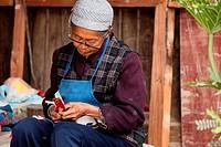 Embroidery textile work, puzhehai, Yunnan province, China