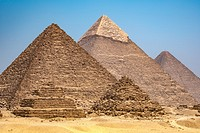 Cairo, Egypt The three Great pyramids of Giza against a clear blue sky. From left to right stands the Pyramid of Mekaure (smallest of the three), Pyra...