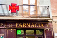 Pharmacy sign in a street. Barcelona, Catalonia, Spain.