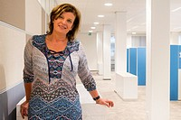 Breda, Netherlands. Business office portrait of a female mid adult manager, working inside a public organisation.