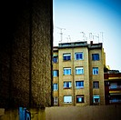 Apartment building with tv antennas on rooftop, facade with windows. Barcelona, Catalonia, Spain.