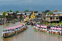 Myanmar, Shan State, Inle Lake festival, Leg rowers towing in unison the royal barge to Phaung Daw Oo pagoda.