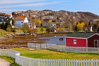 Homes and a white picket fence in early spring. Brigus, Newfoundland, Canada.