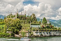 Terraced garden of Palazzo Borromeo at Isola Bella, Lago Maggiore, seen from the lakeside, Piemont, Italy.