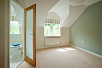UK homes. A property development show home bedroom and ensuite. For Editorial Use Only.