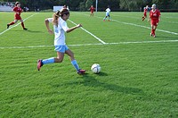 Teen playing high school soccer