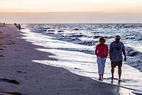 Florida, Sanibel Island, dawn, sunrise, surf, Gulf of Mexico, shellers shell hunters, beachcombers, man, woman, couple,