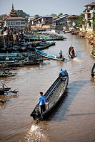 Traditional taxi boats along a water canal in Nyaungshwe, Inle Lake, Myanmar.