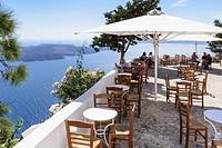 Santorini cafe balcony with panoramic views of the caldera, Firostefani, Santorini, Cyclades, Greece.