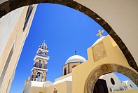 Framed arch views of St. John the Baptist Cathedral in Fira, Santorini, Cyclades, Greece.