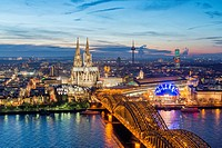 Evening view of skyline of Cologne, Germany with floodlit Cathedral prominent.