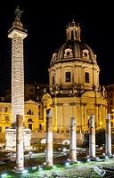 Trajan's Column in Trajan's Forum and Santissimo Nome di Maria al Foro Traiano Church, Rome, Italy, Europe.