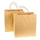 Empty brown recycled paper shopping bags isolated on white background. Side view.